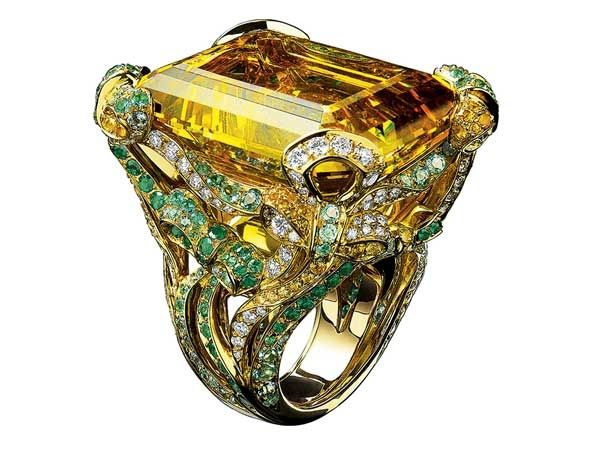 A ball of fire Ring. Dior ring features an incredible yellow topaz, enveloped by brilliant-cut diamonds and emeralds.