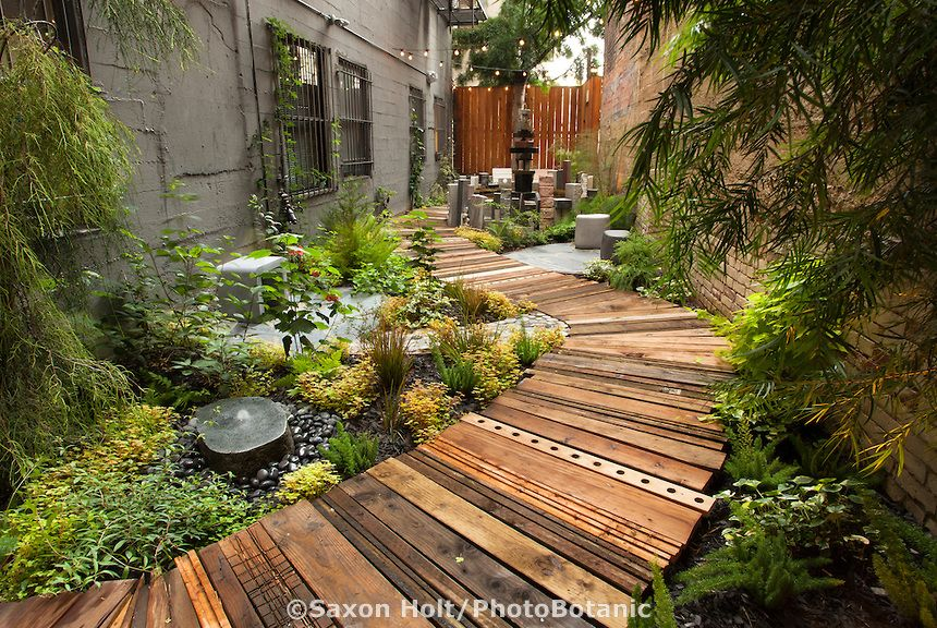 Recycled Wood As Boardwalk Path In Narrow Garden The Mark