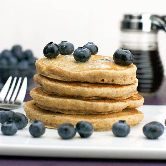 Healthy Whole Wheat Blueberry Pancake:     2 cups fat-free milk     1 and 1/2 cups whole-wheat flour     1 cup fresh (or thawed frozen) blueberries     3/4 cup all-purpose flour     4 egg whites (or two eggs) - beaten     1 Tablespoon canola oil     2 teaspoons baking powder     1/2 teaspoon salt     1/4 teaspoon vanilla