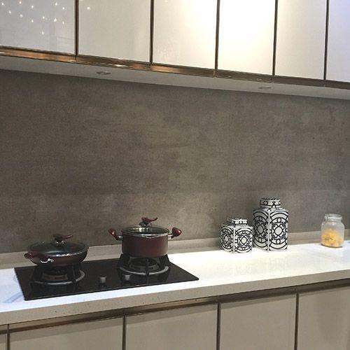 A Kitchen Splashback Featuring Persian Grey Stone Effect Large Format Porcelain Tiles