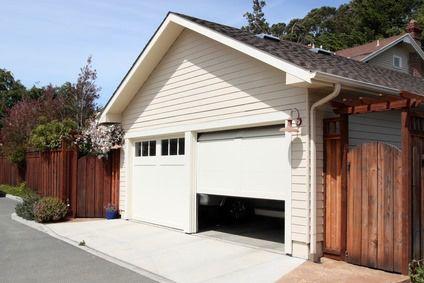 Intruders Don T Like Light Or Garage Doors Down The Sleeping Blog Garage Doors Garage Door Design Garage Door Springs