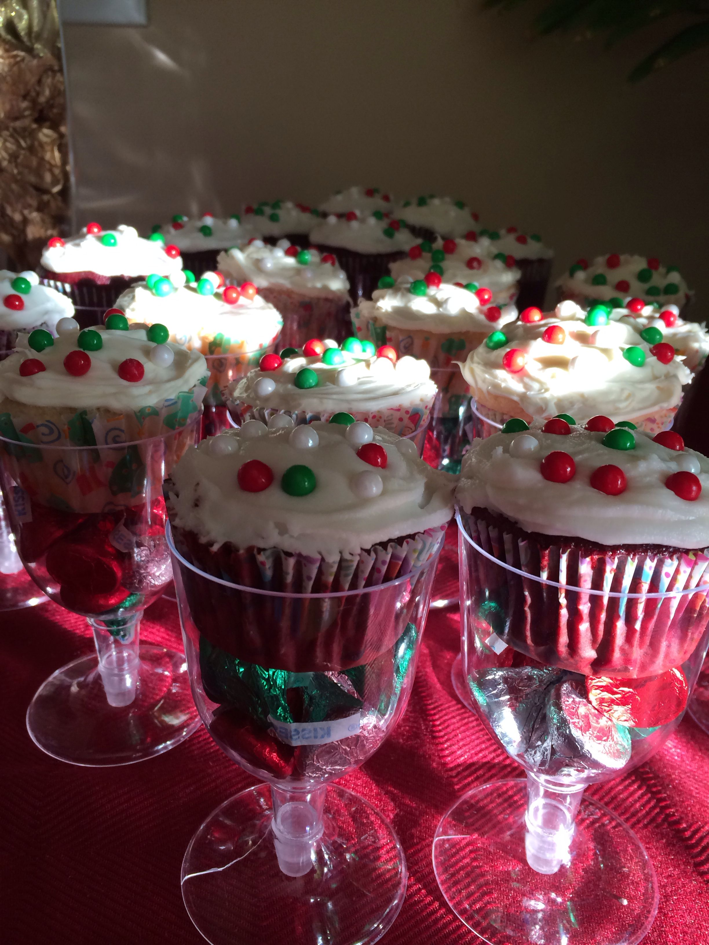 Christmas Cupcakes In A Plastic Wine Glass With Kisses At