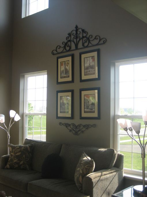 Two story living room our two story living room is right - How to decorate tall walls ...