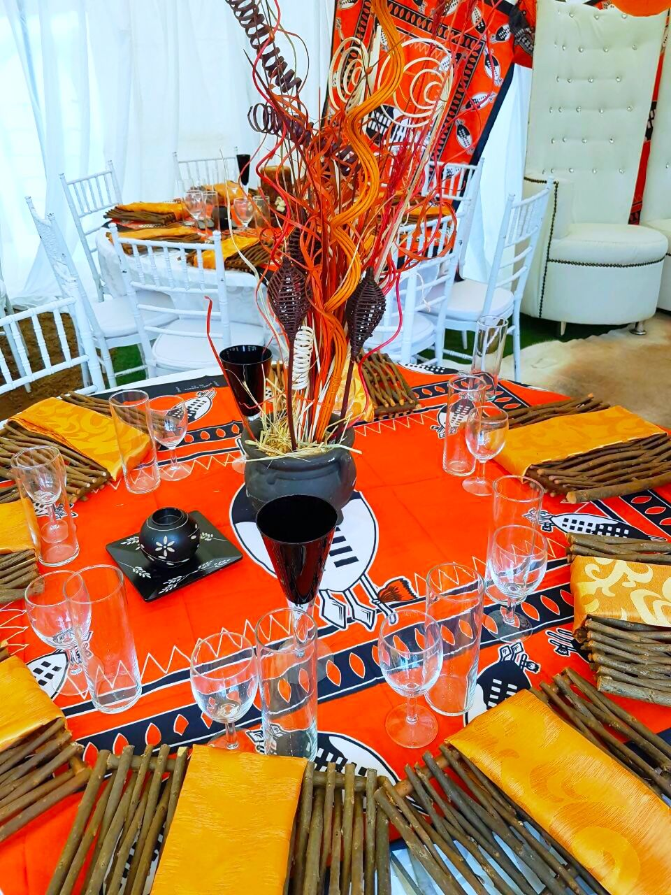 Orange and black Swazi traditional wedding decor at Shonga Events ...