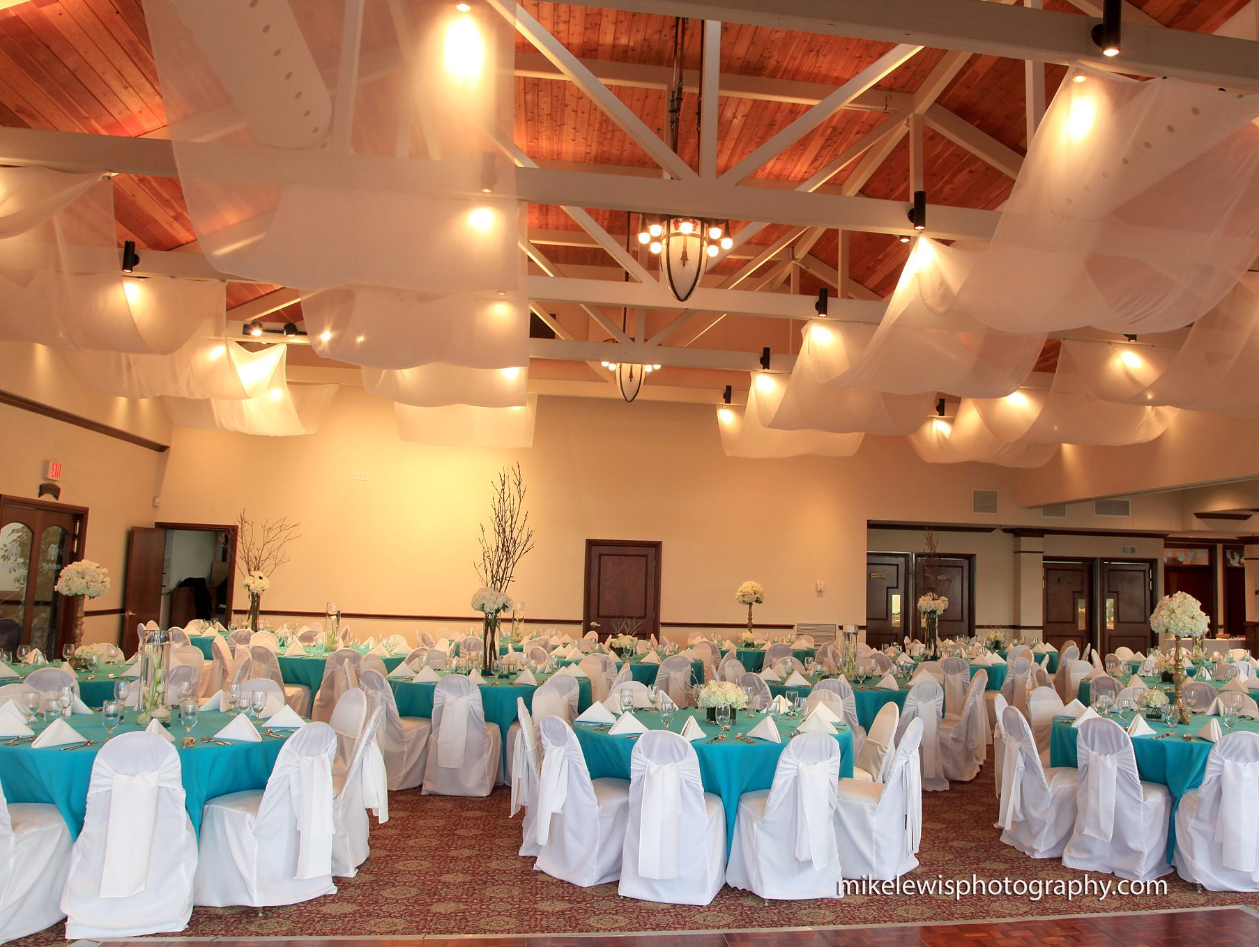 Ballroom Reception With Floor Length Turquoise Linens And White Naps, Chair