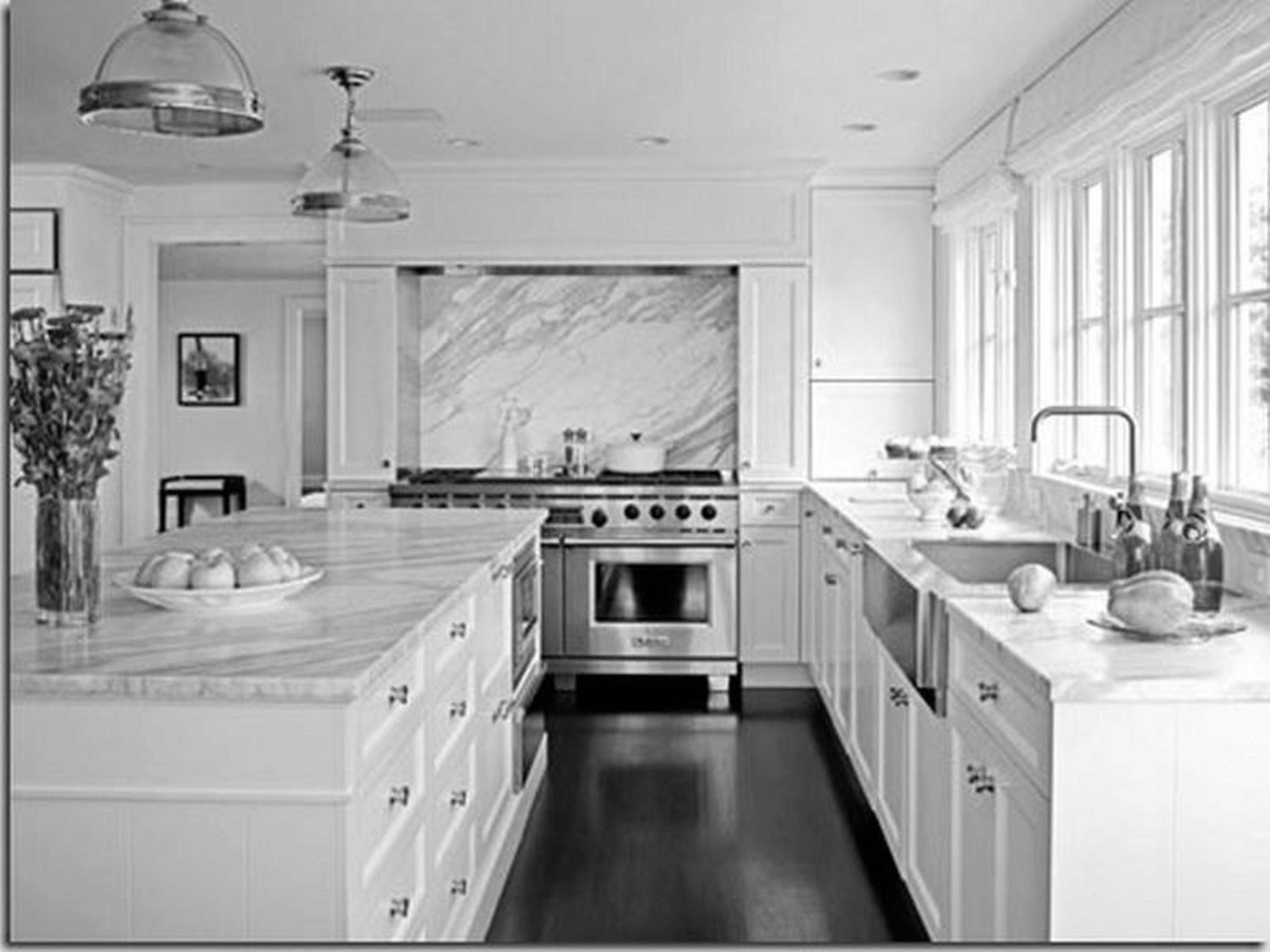 White Kitchen Cabinets With Dark Quartz Countertops