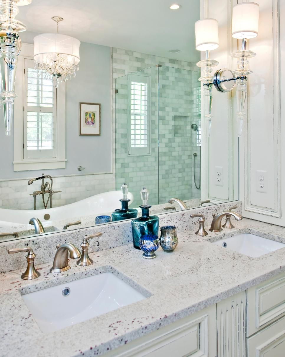 Weathered White Cabinetry Jewel Like Lighting And Marble Tiled Walls Create Spa Feel