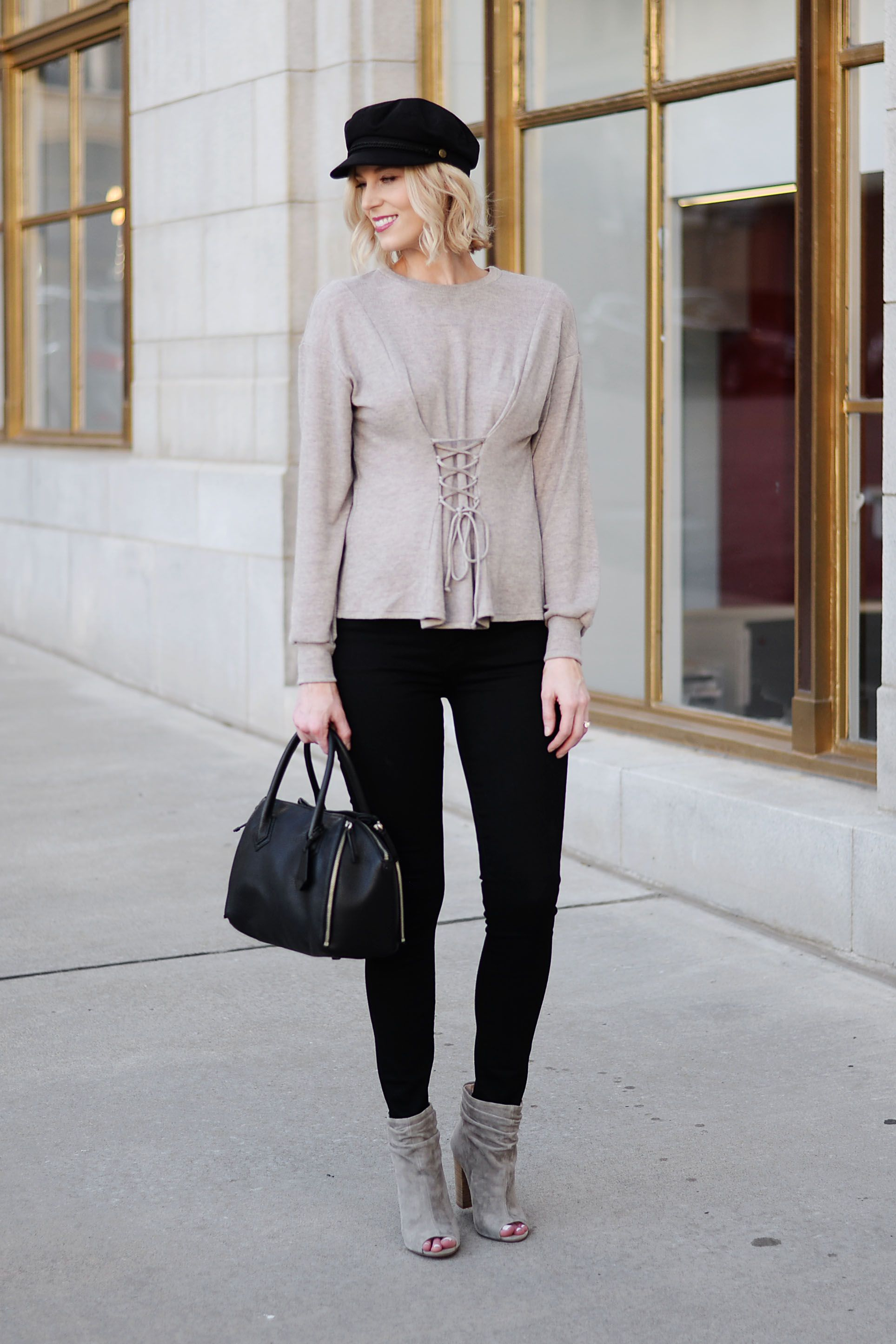 e18464f1b25 seriously slimming corset style top with black jeans baker boy hat and  slouchy booties - all of fall s hottest trends in one look!