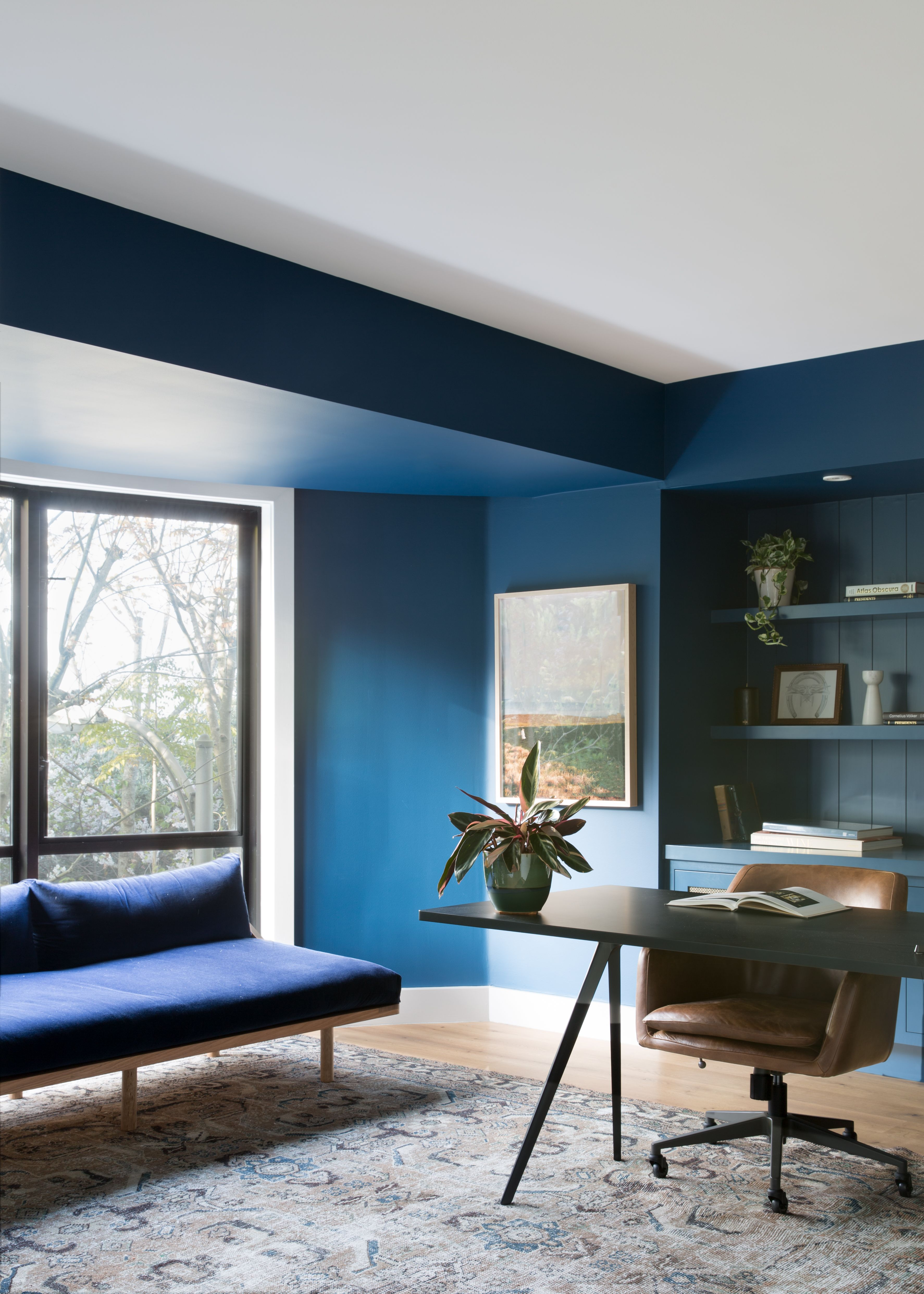 This Cool Couple S F Apartment Balances Moody Spaces With Neutral Ones And It Works Hunker Home Indigo Walls Interior