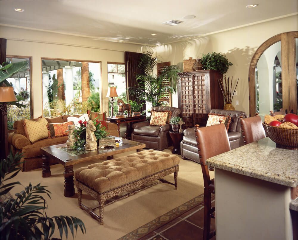 50 beautiful living rooms with ottoman coffee tables orange sofa luxurious living room awash in multiple exotic textures featuring marble topped bar table leather geotapseo Images