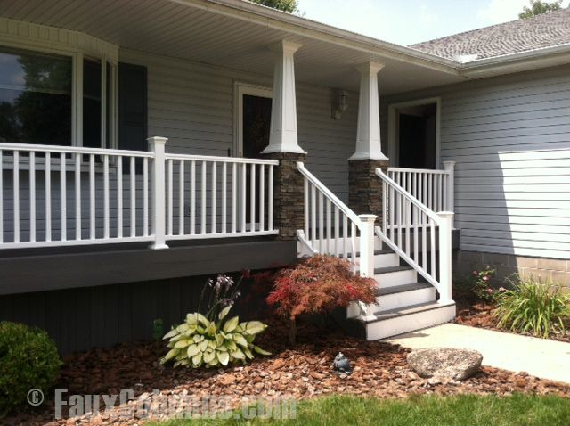 White Vinyl Fence Terminates Into Stacked Stone With White Trim Tapering Atop The Columns Exterior Commercial Remodeling House Exterior
