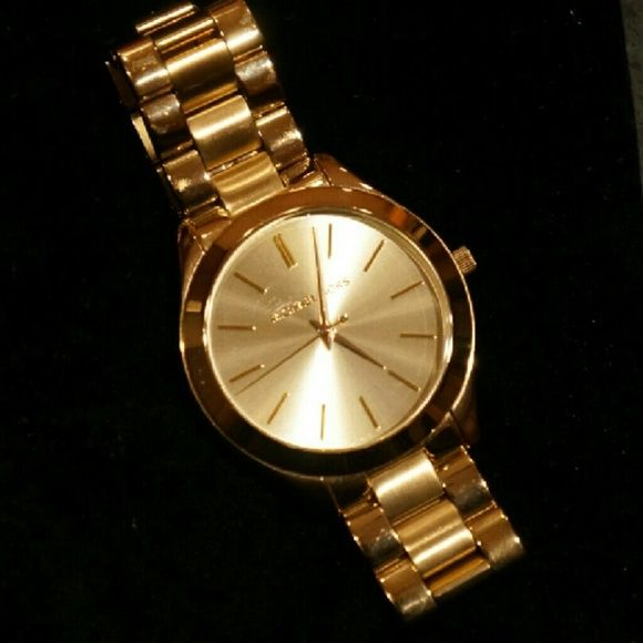 Michael Kors Women's Slim Runway Gold Watch Beautiful gold MK watch to match anything! Small scuff on front face and signs of wear on reverse side. Michael Kors Accessories Watches
