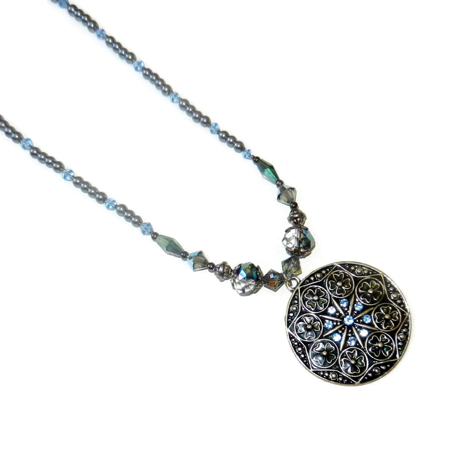 A personal favorite from my Etsy shop https://www.etsy.com/listing/238656042/blue-and-silver-beaded-necklace-with