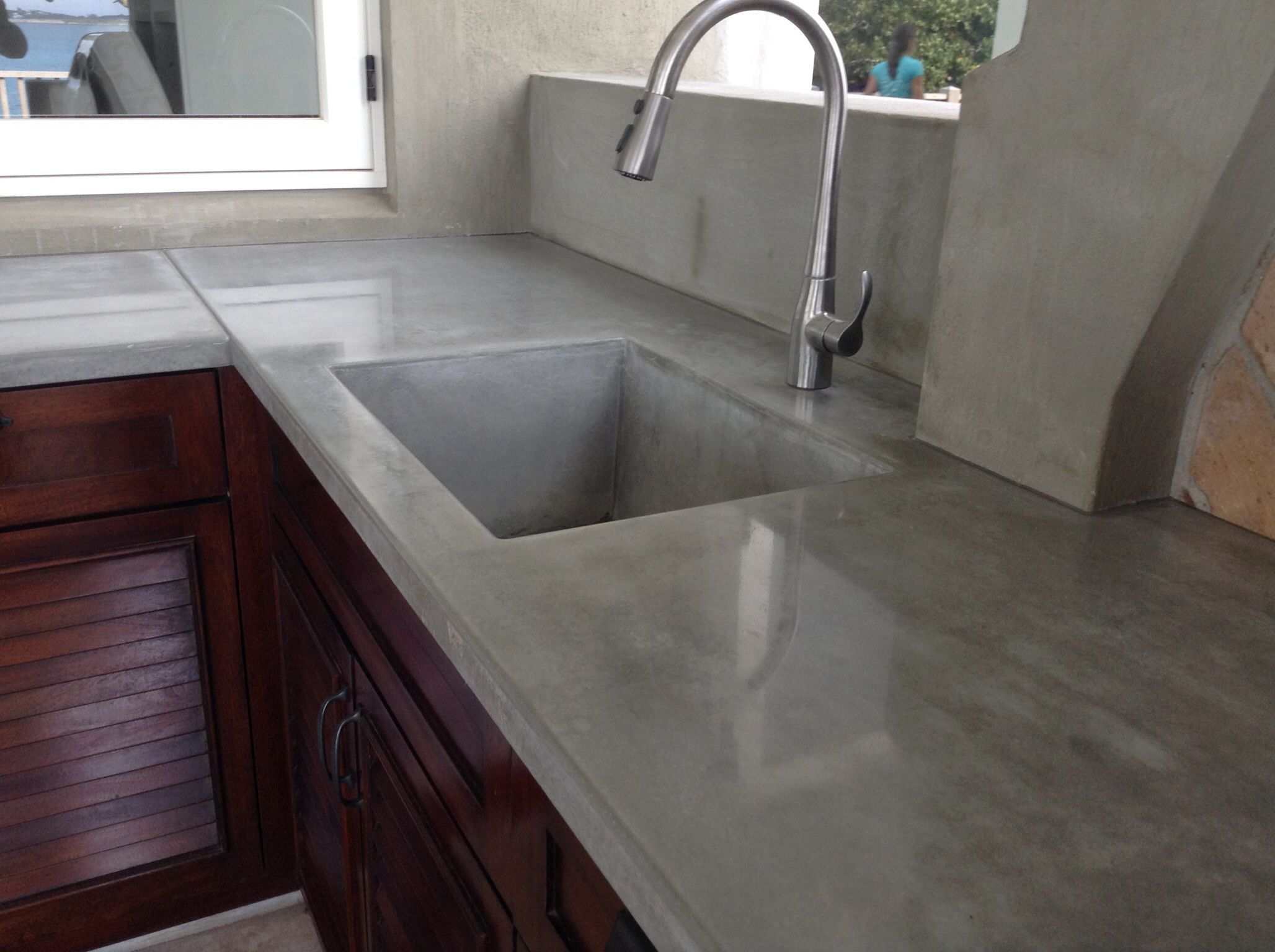 Concrete BBQ Counter With Integral Concrete Sink.