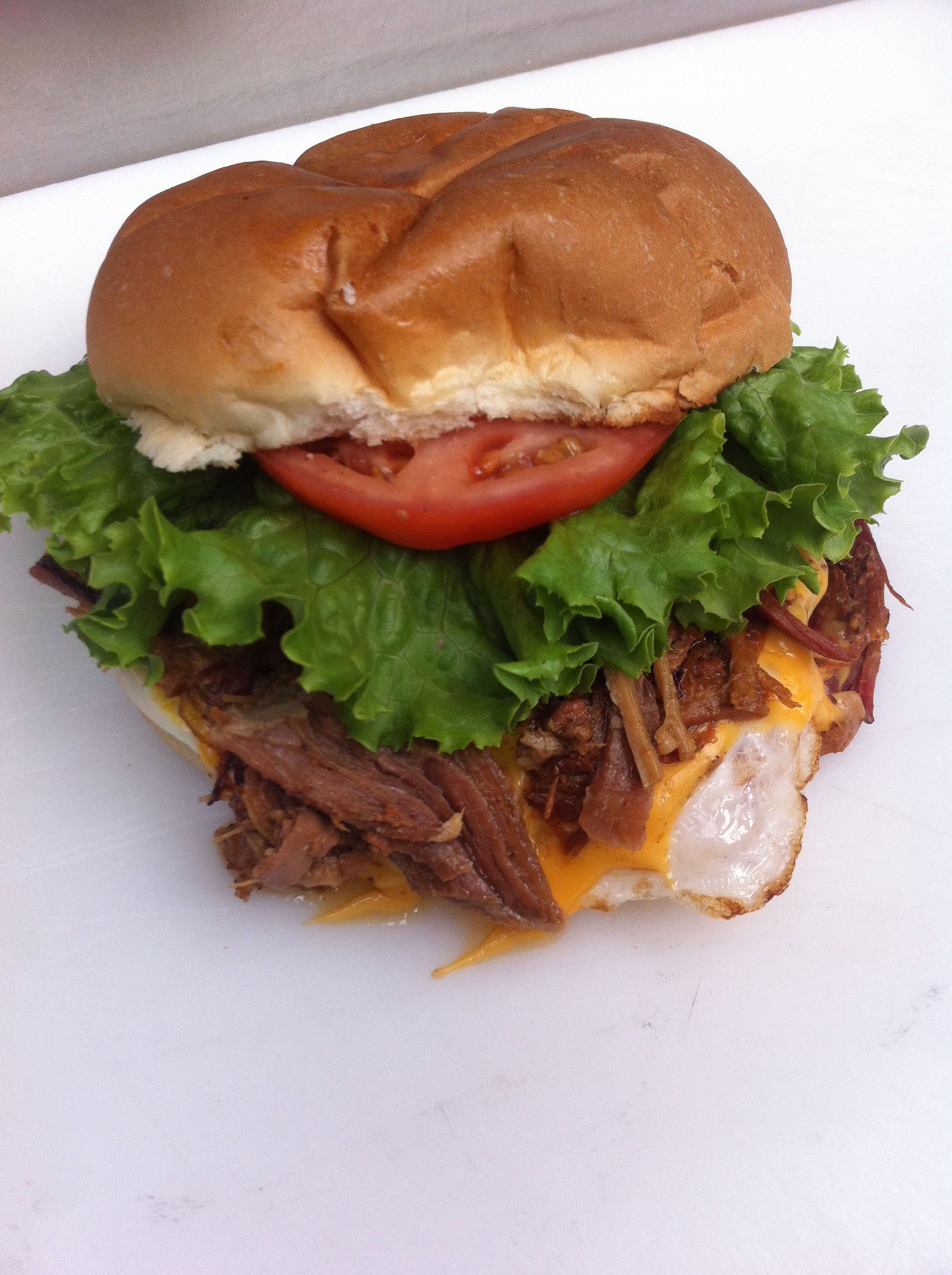 Pulled pork egger- toasted bun,egg,cheese,pulled pork and veggies. Great with coleslaw instead of lettuce&tomato