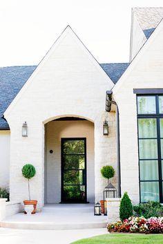 white brick house with black trim windows