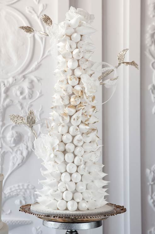 Lighter-than-air meringues get the royal treatment when decorated with sugar flowers and leaves.