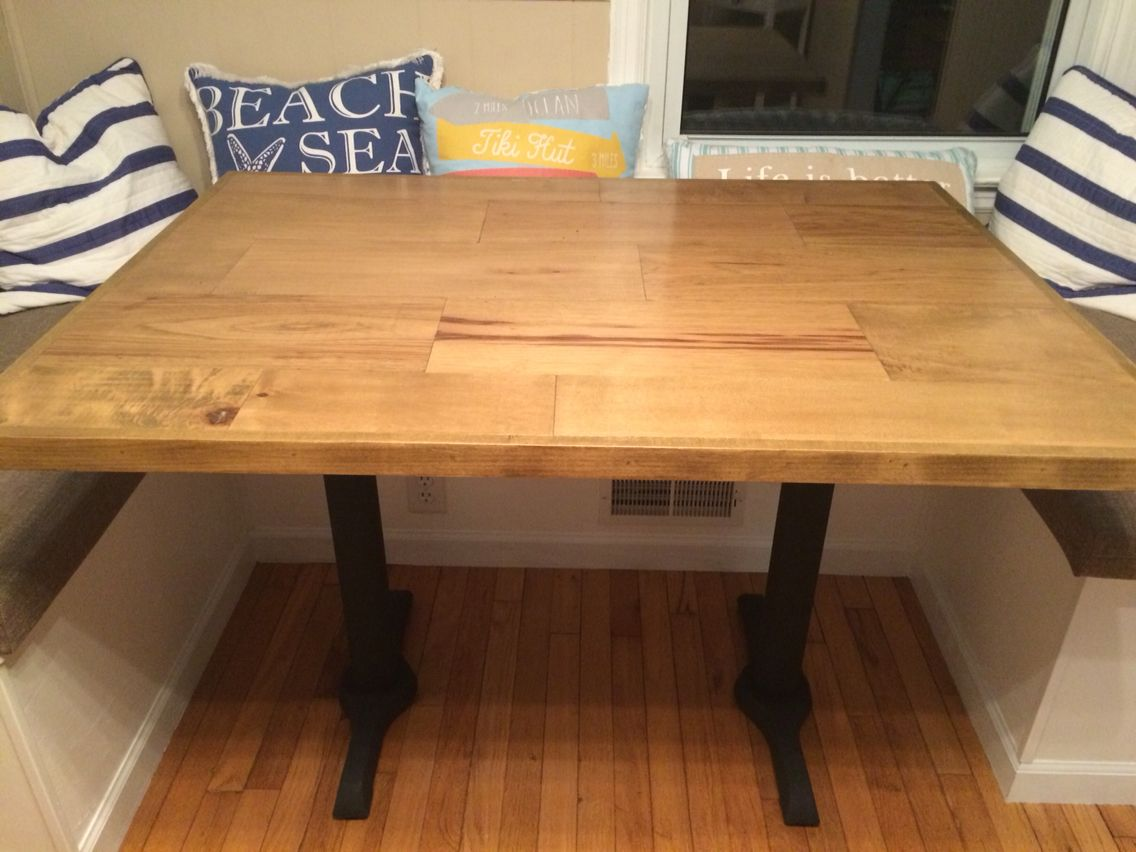 Dining table made out of scrap wood flooring.  Dining table