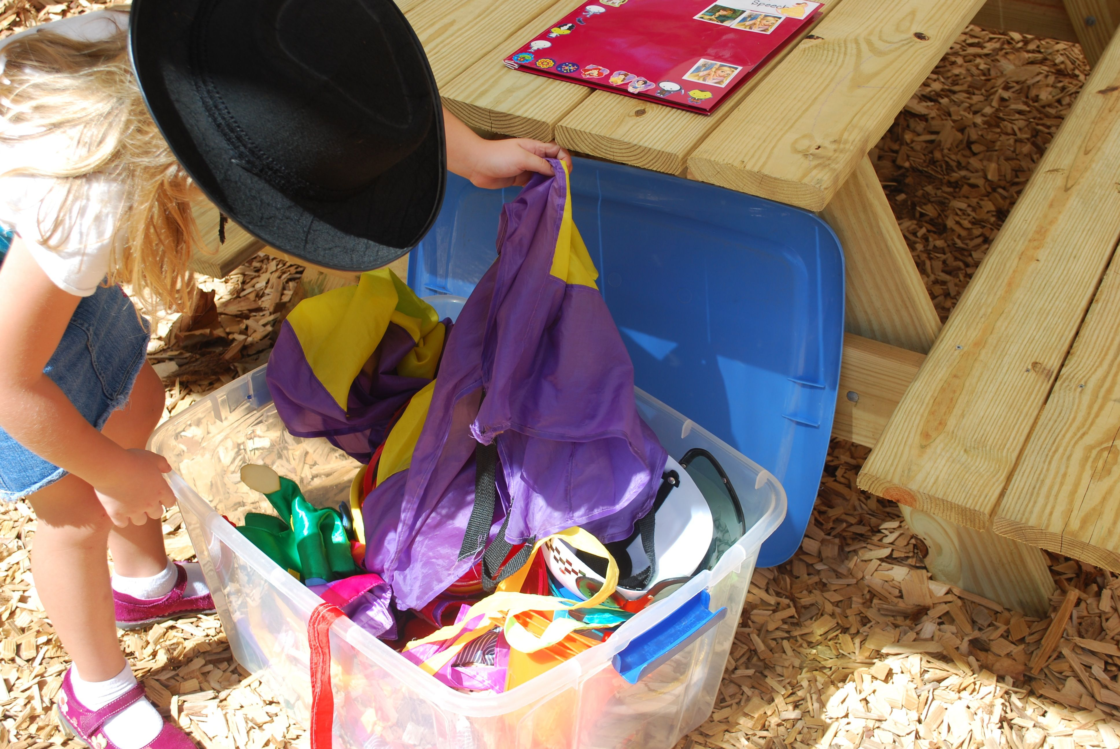 Perfect combination of nature and nurture. Fill a large Rubbermaid with different items (hats, scarfs, binoculars, telescopes, ribbons, capes, etc.). Let the child explore the bin outside, to express themselves in different ways.