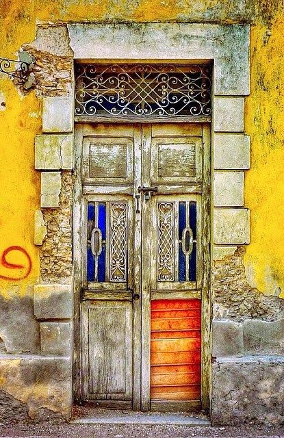 love this door at Mexico, love the raw finish to it and the way it has a tint of orange and the yellow on the wall, just so well composed