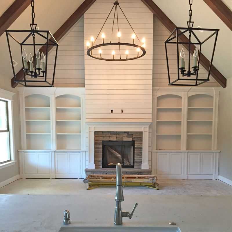 Farm house · example of built ins with shiplap above and wood beams also circle chandelier for