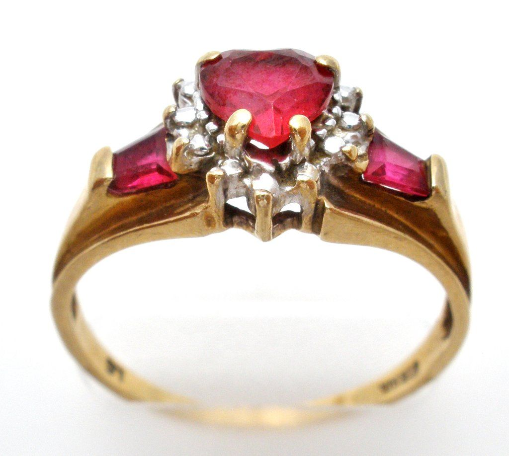 Red Gemstone Jewelry This Is A 10k Yellow Gold Ring With A 5 Carat Ruby Heart Center With Two 25 Ruby Sides Ston Jewelry Red Gemstone Jewelry Red Gemstones