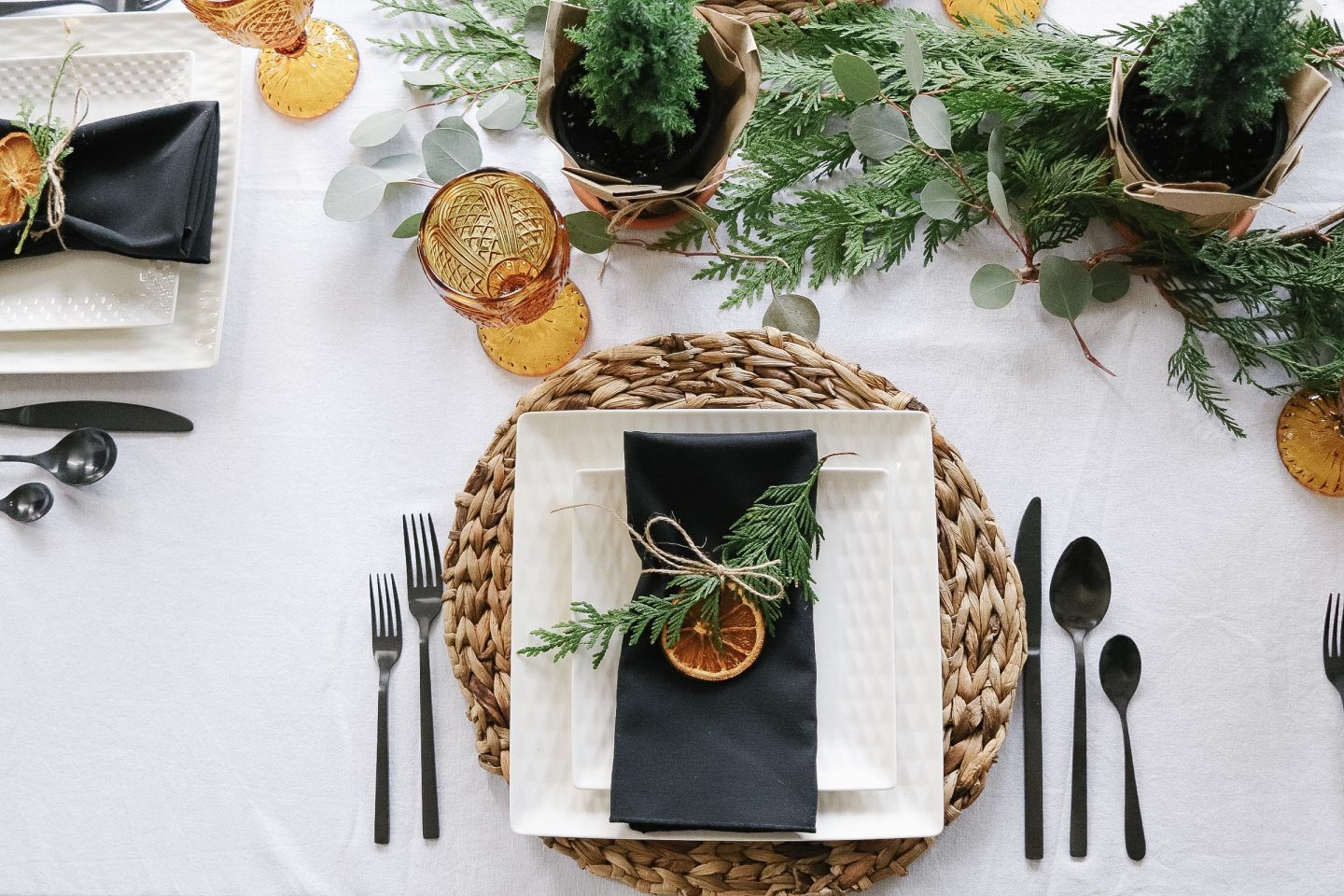 A scandinavian christmas tablescape with natural elements