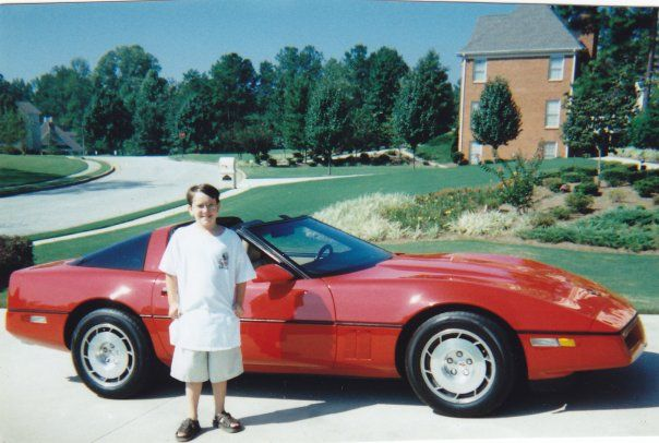 My son Zach with one of my older Vettes