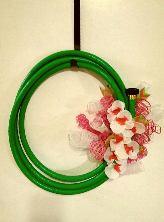 Check out this item in my Etsy shop https://www.etsy.com/listing/230803028/spring-and-summer-garden-hose-wreath