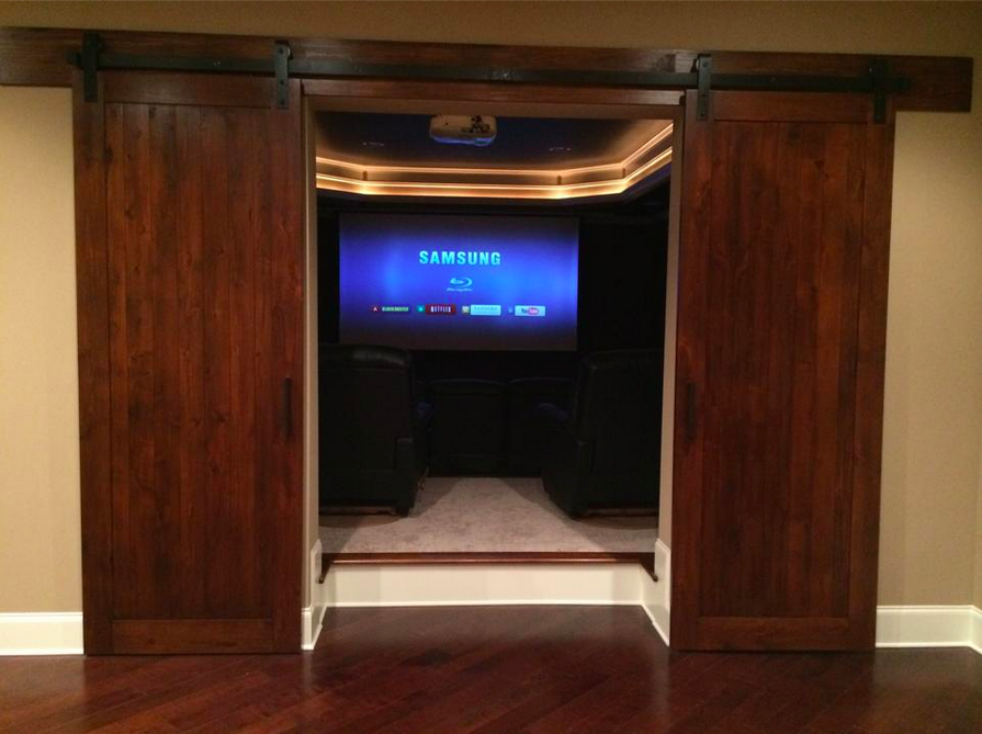 Barn doors as a grand entrance into her indoor theater ...