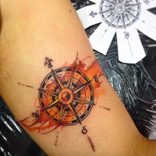 Amazing Orange Ink Vintage Compass Tattoo On Men Biceps Tattoos