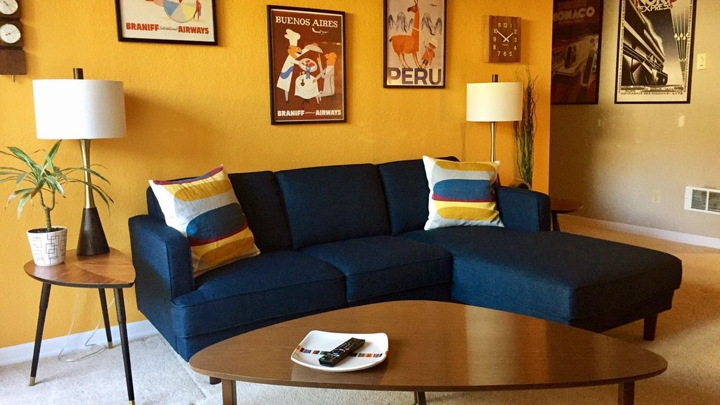 Home Interior Design Blue Sofa Against Yellow Wall Ddd Liam Sectional Yellow Walls Living Room Blue Sofas Living Room Teal Living Room Decor