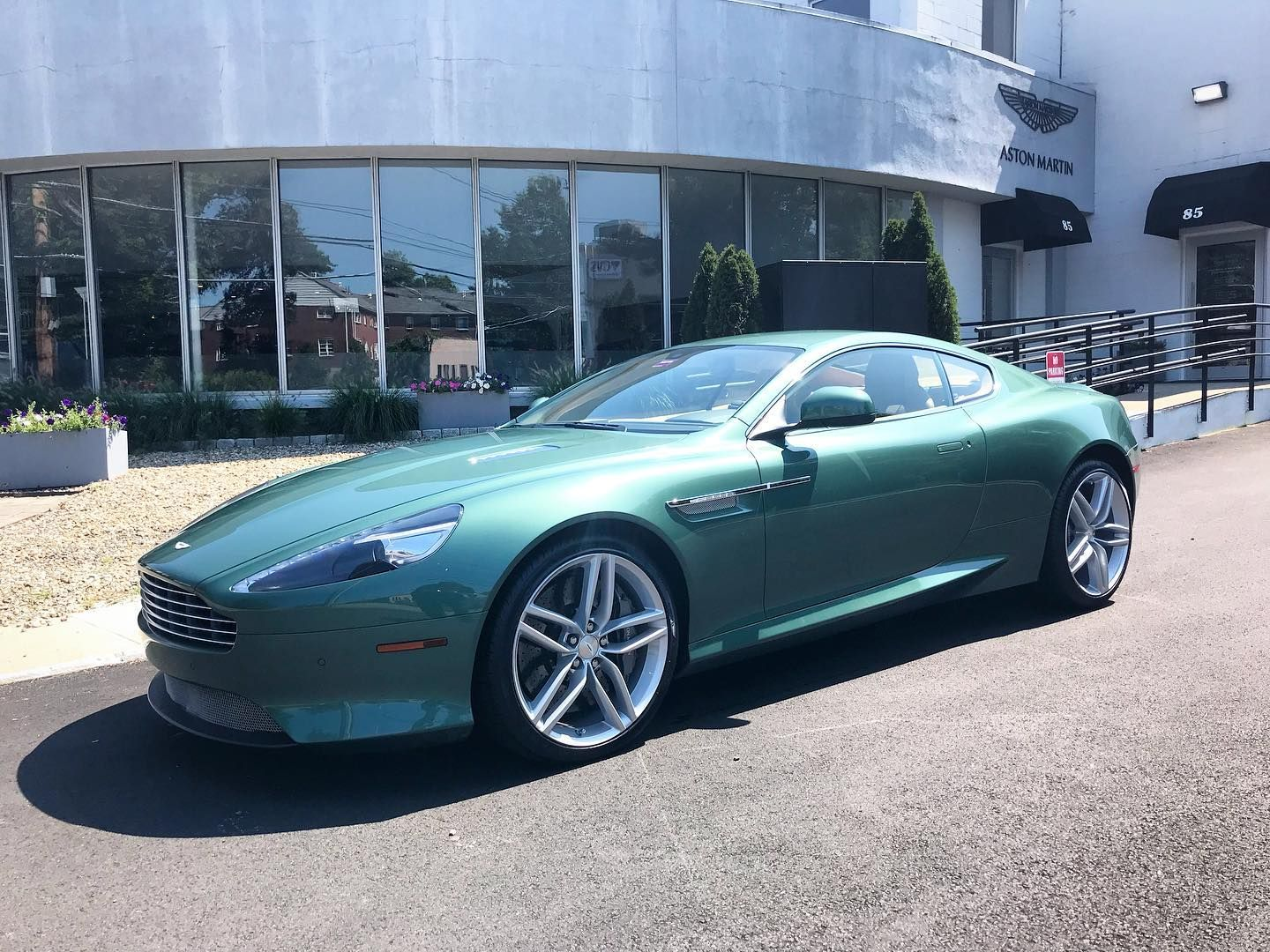 always nice to see this green db9 for service new tires and prepped for a cross country trip astonmar in 2020 cross country trip new tyres aston martin pinterest
