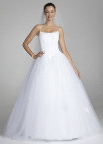 Luxurious and elegant, you will look and feel like a modern day princess in this gorgeous tulle ball gown!   Spaghetti strap bodice features eye-catching and stunning corded lace corset detailing.  Full tulle ball gown adds dimension and drama to this already beautiful gown. Chapel train.  Available in stores and online in White.  Fully lined. Back zip. Imported polyester. Dry clean.