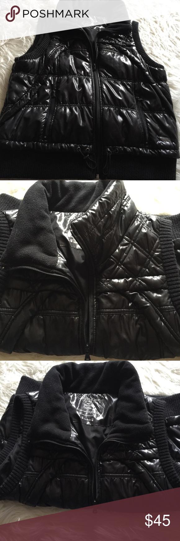 Calvin Klein sleeveless black jacket. L. Very good