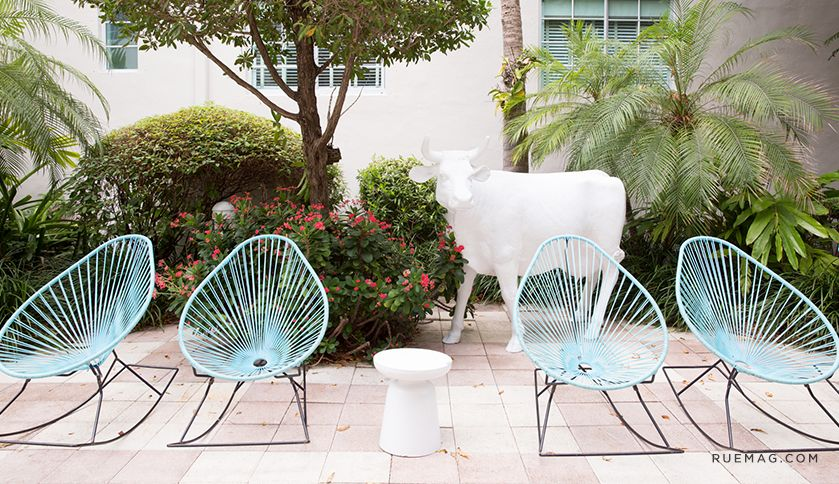 Vibrant style that's complete with blue rocking chairs at Surfcomber in South Beach.