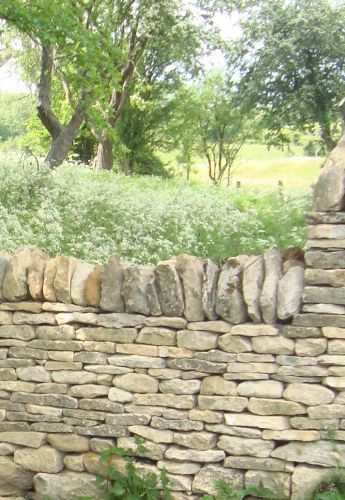 Cotswold walling stone - love the dry stack on their sides, then the top detail on the ends.
