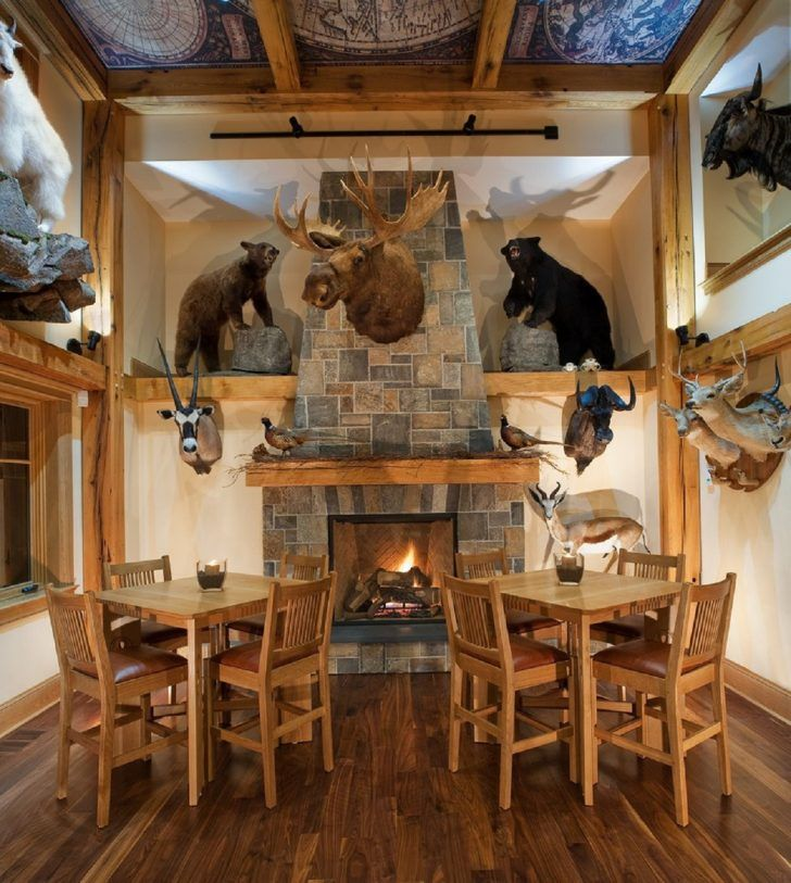 Trophy Room Design Ideas Part - 28: Photo Of Rustic Man Cave Dining Room With Stone Fireplace And Wall Mounted  Hunting Trophy Animals From Gallery Of Superb Man Cave Room Ideas.