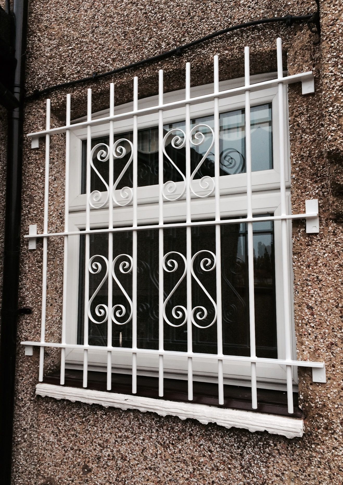 Decorative Security Grilles For Windows Rsg2000 Security Bars Fitted Externally To The Back Window Of A