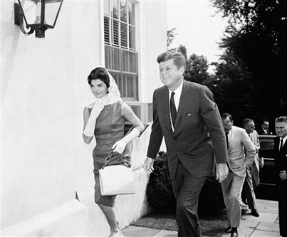 President John F. Kennedy and first lady Jacqueline Kennedy arrive at the Middleburg Community Center before attending Roman Catholic Church services.
