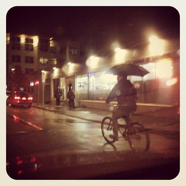 bike rider with umbrella in #nepdx  Photo by josephrose