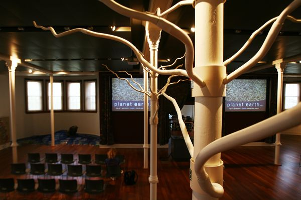 Fake trees made out of PVC pipes branch off support beams as