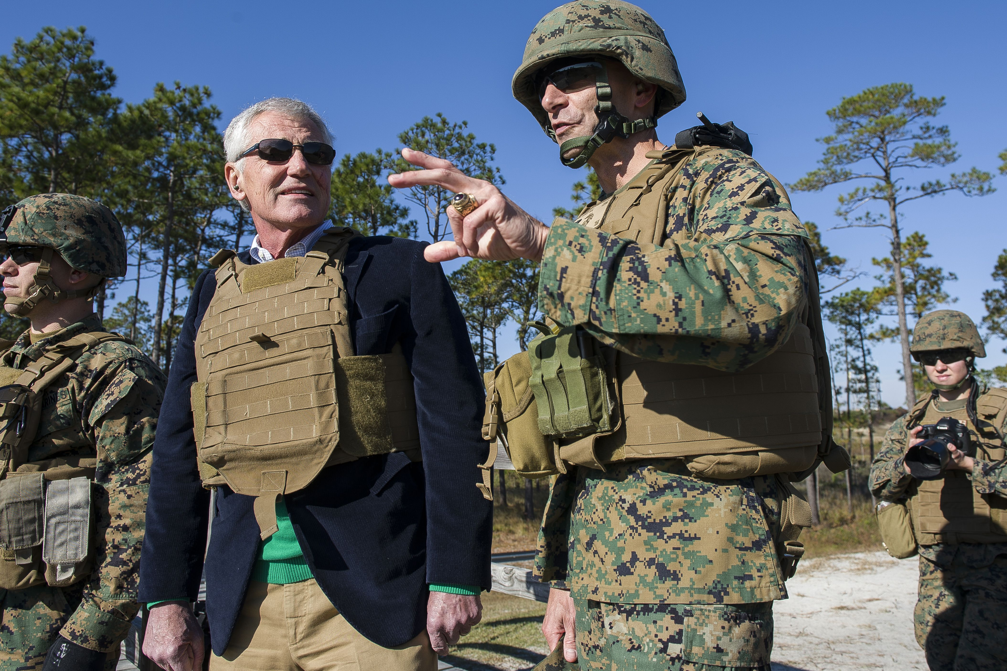 Defense Secretary Chuck Hagel observes female Marines fire shoulder-launched assault weapons on Camp LeJeune, N.C., Nov. 18. 2014. The Marines are assigned to Ground Combat Element Integrated Task Force.