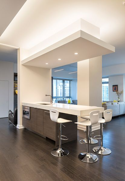 Soft Strip Emphasizes The Interesting Geometric Shapes Created By The Cove Ceilings Inside Th Kitchen Ceiling Design Ceiling Design Modern Ceiling Light Design