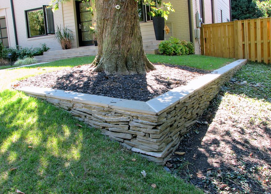 Stone walls landscaping dry stacked stone wall with a cut flagstone cap in arlington stone - Stone fences garden designs ...