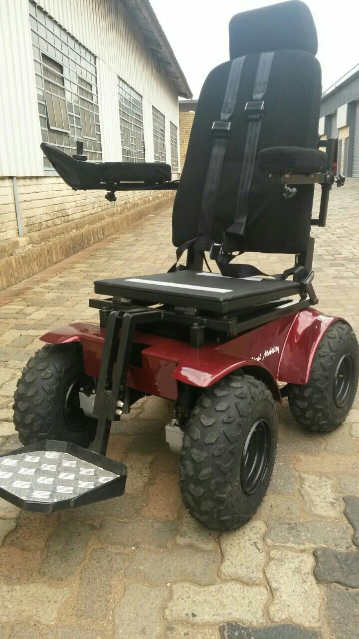 predator 4x4 power wheelchair with cool deep red paint job and 4 point  harness