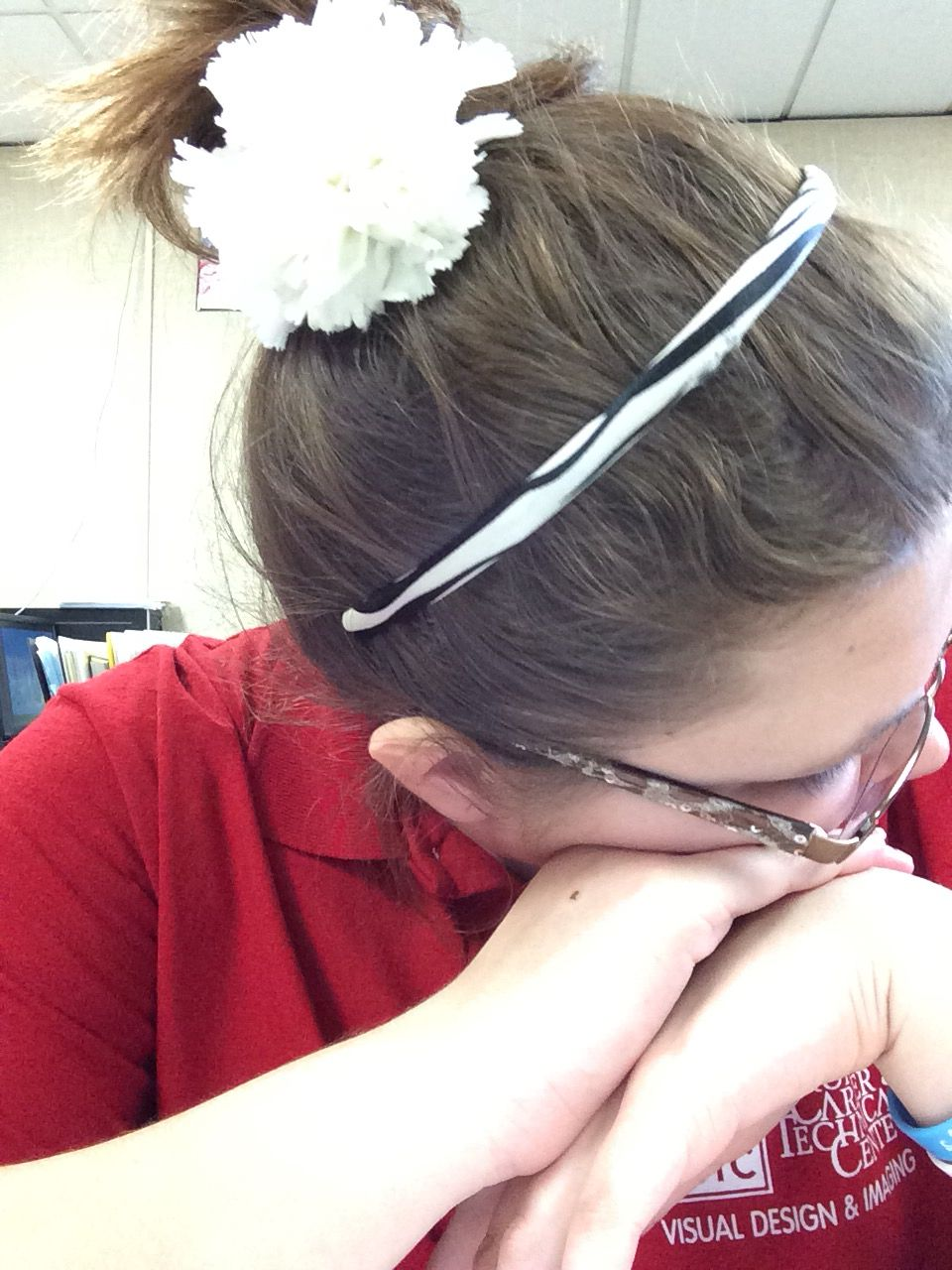 My messy bun with flower for the day