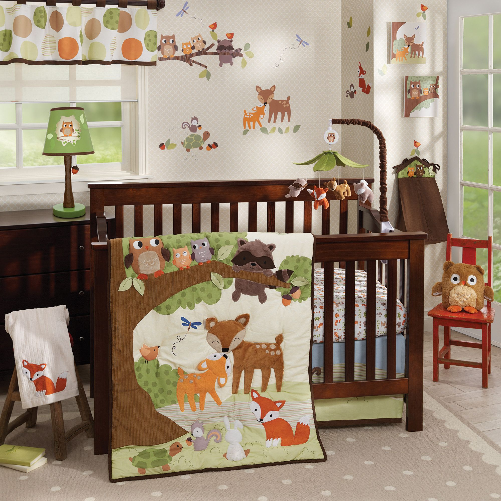 transform your nursery into a forest full of animal friends with the woodland tales bedding collection from lambs ivy the collection includes a bedding set - Woodland Nursery Decor