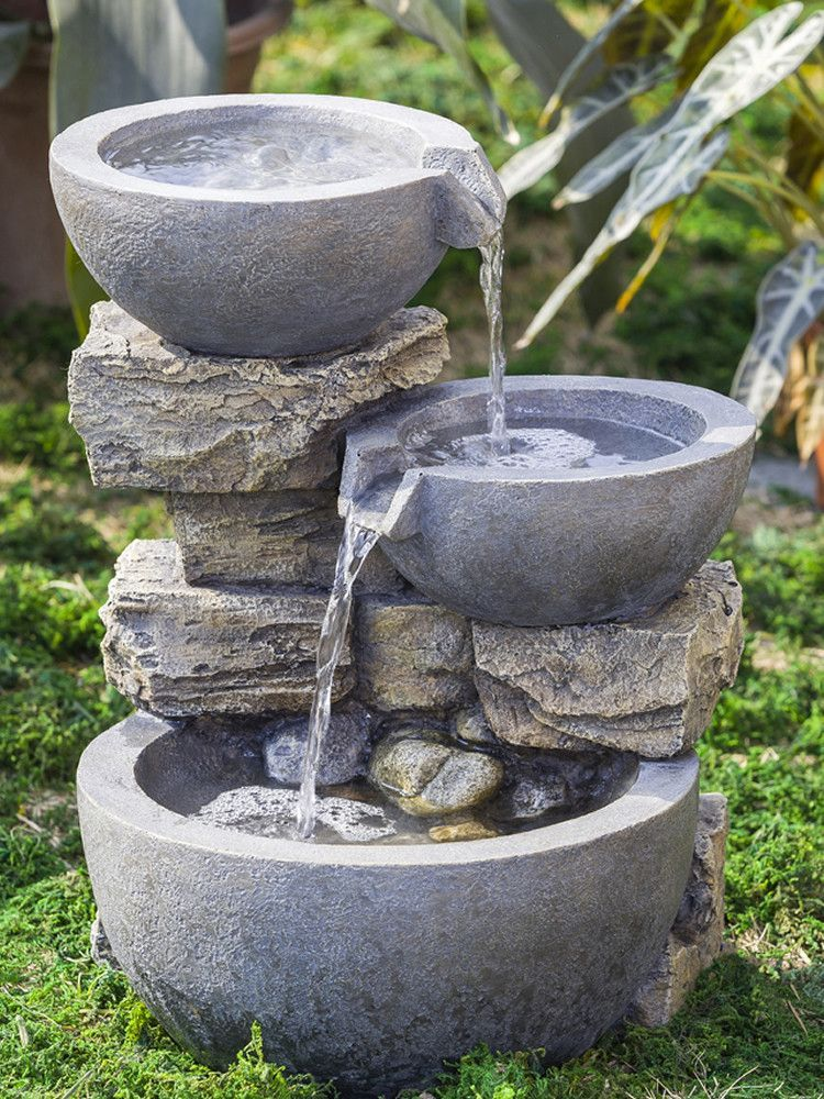 With rounded bowls water dances from tier
