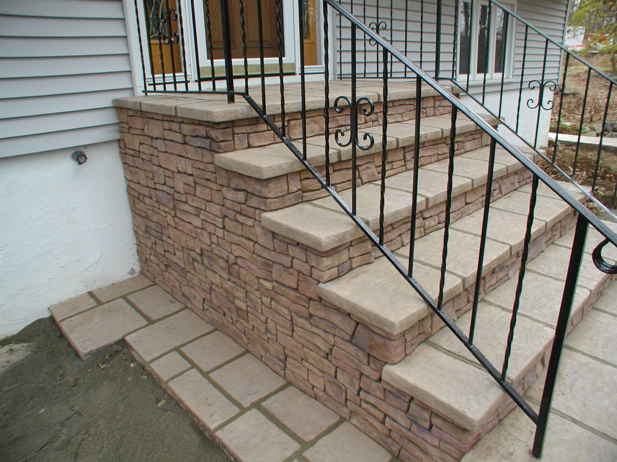 A Hand Crafted Stone On An Entryway Over Existing Concrete